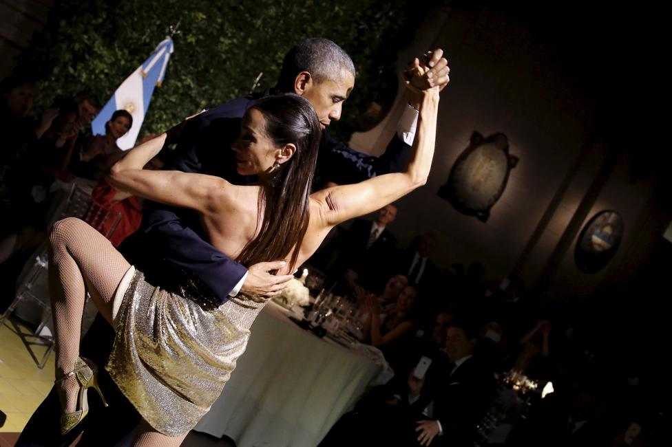U.S. President Barack Obama dances tango during a state dinner hosted by Argentina's President Mauricio Macri at the Centro Cultural Kirchner in Buenos Aires