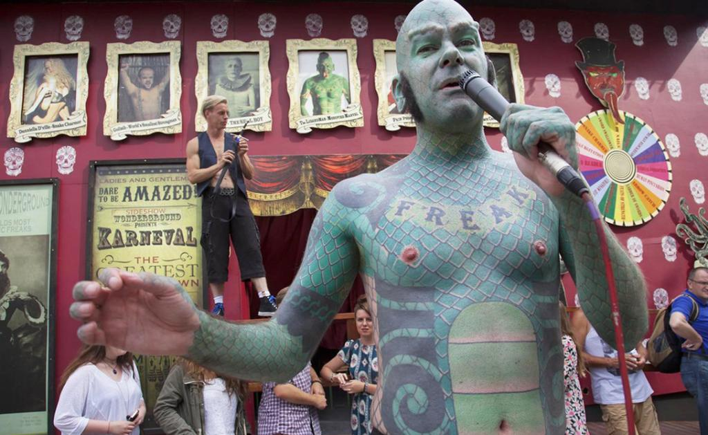 UK - South Bank - Members from the London Wonderground sideshow freakshow perform a free show to entice in customers