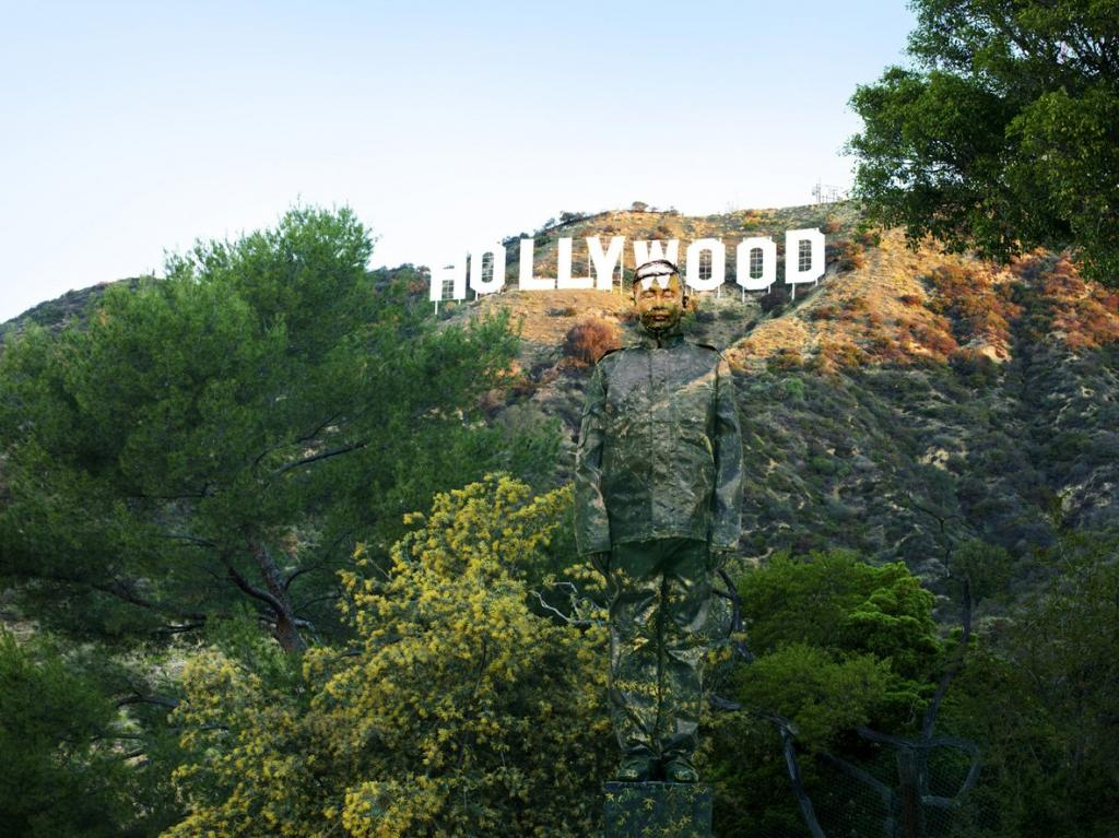some-of-his-pieces-are-more-intricate-here-he-stands-in-front-of-the-hollywood-sign-in-california