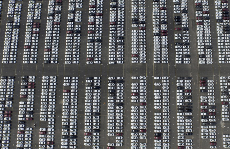 An aerial picture shows new Chevrolet cars at a General Motors' parking lot in Shenyang