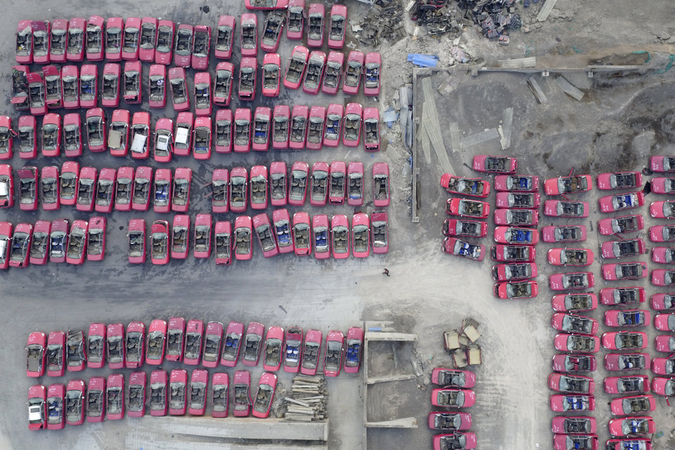 Scrapped taxis are seen in a parking lot in Taiyuan as the city is adapting to electric taxis, Taiyuan