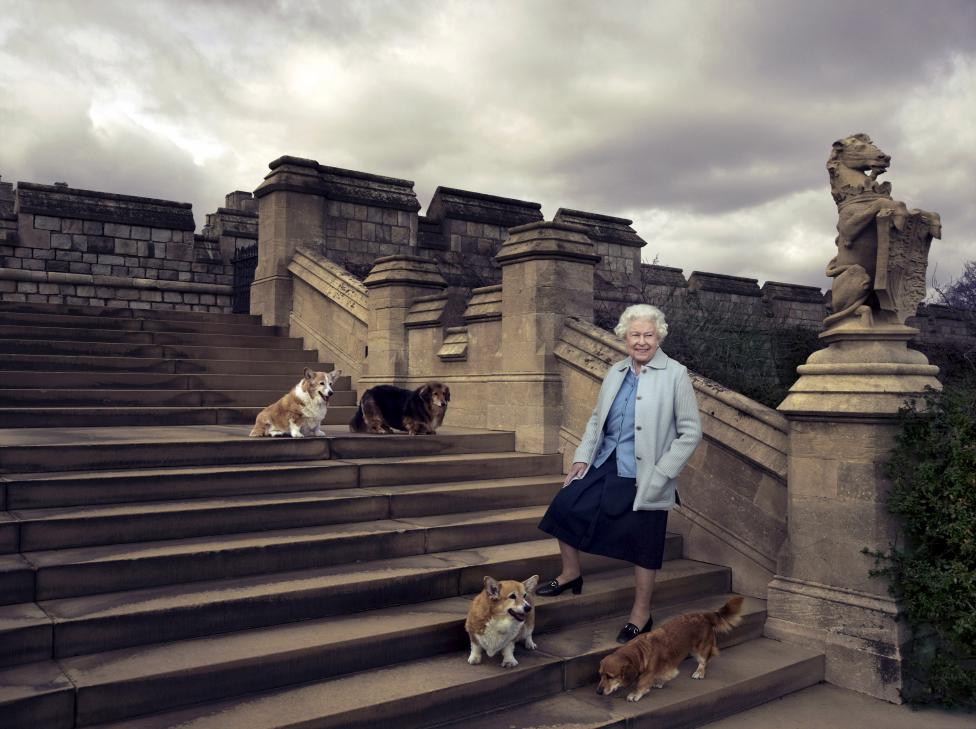Britain's Queen Elizabeth II is seen walking in the private grounds of Windsor Castle on steps at the rear of the East Terrace and East Garden with four of her dogs