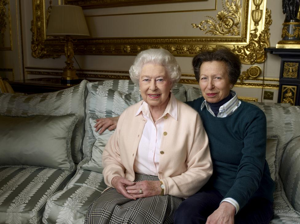 Britain's Queen Elizabeth II is pictured with her daughter, The Princess Royal, in the White Drawing Room at Windsor Castle