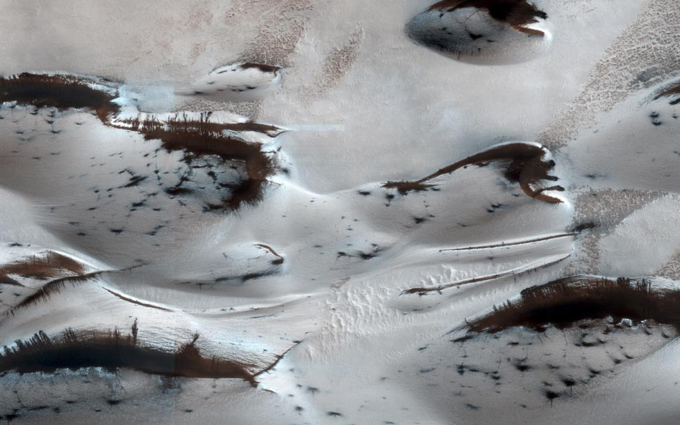 Mars' northern-most sand dunes begin to emerge from their winter cover of seasonal carbon dioxide dry ice