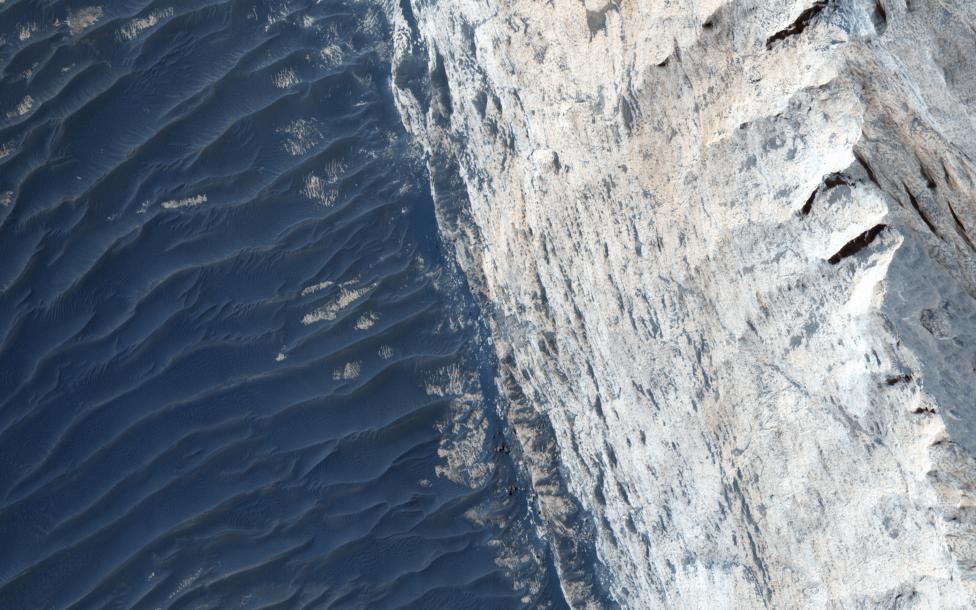 A view of Ophir Chasma on the northern portion of the vast Mars canyon system, Vallles Marineris, taken by NASA's Mars Reconnaissance Orbiter