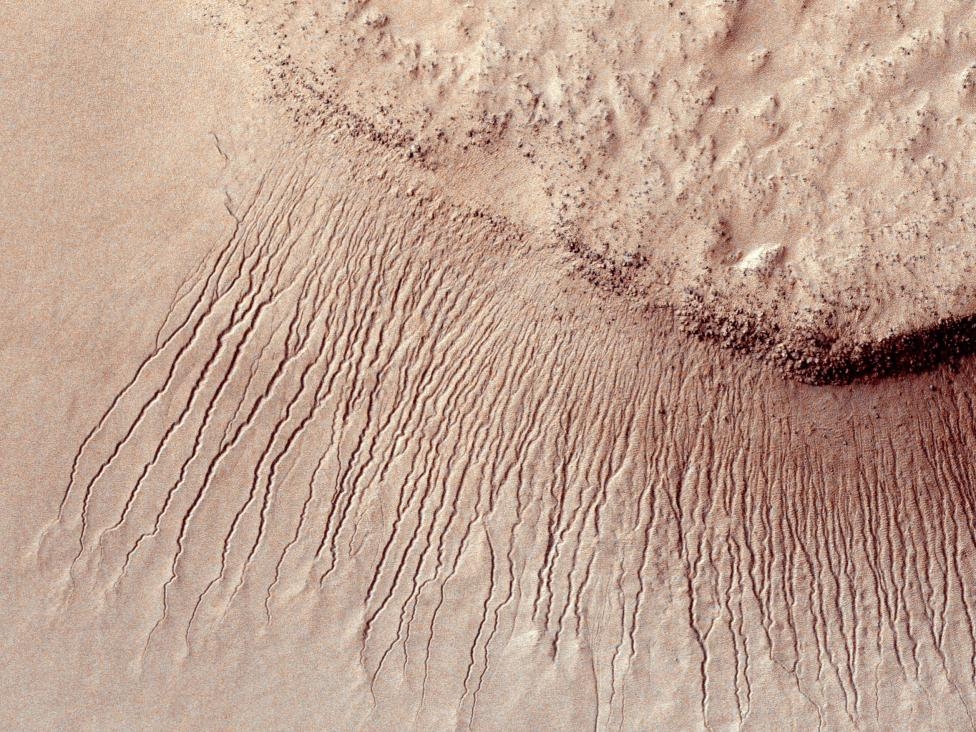 Portions of the Martian surface are pictured from NASA's Mars Reconnaissance Orbiter
