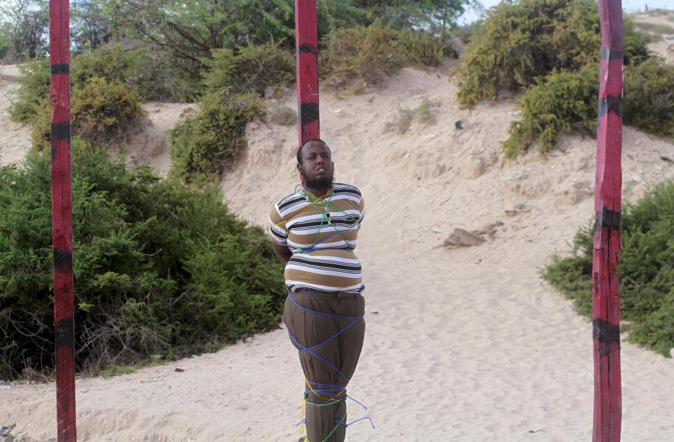Hassan Hanafi, a former media officer for the Somali Islamist group al Shabaab, stands tied to a pole before his execution by shooting at close range on a field in General Kahiye Police Academy in Somalia's capital Mogadishu
