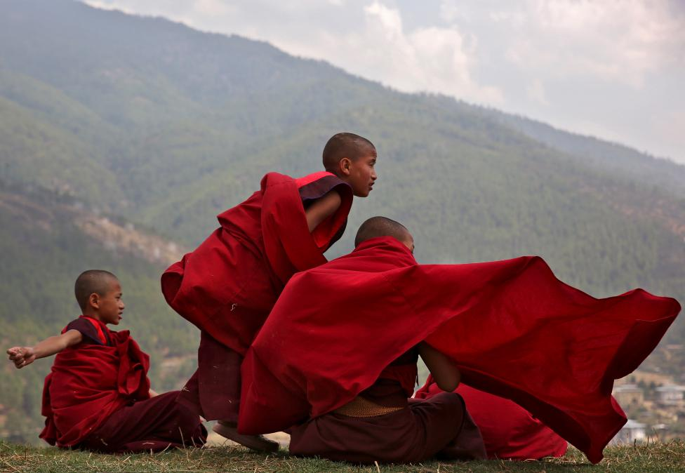 Young monks take a break from their studies at Changangkha Lhakhang temple in Thimphu