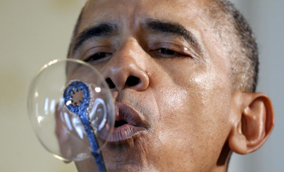 Obama blows bubbles during the White House Science Fair at the White House in Washington
