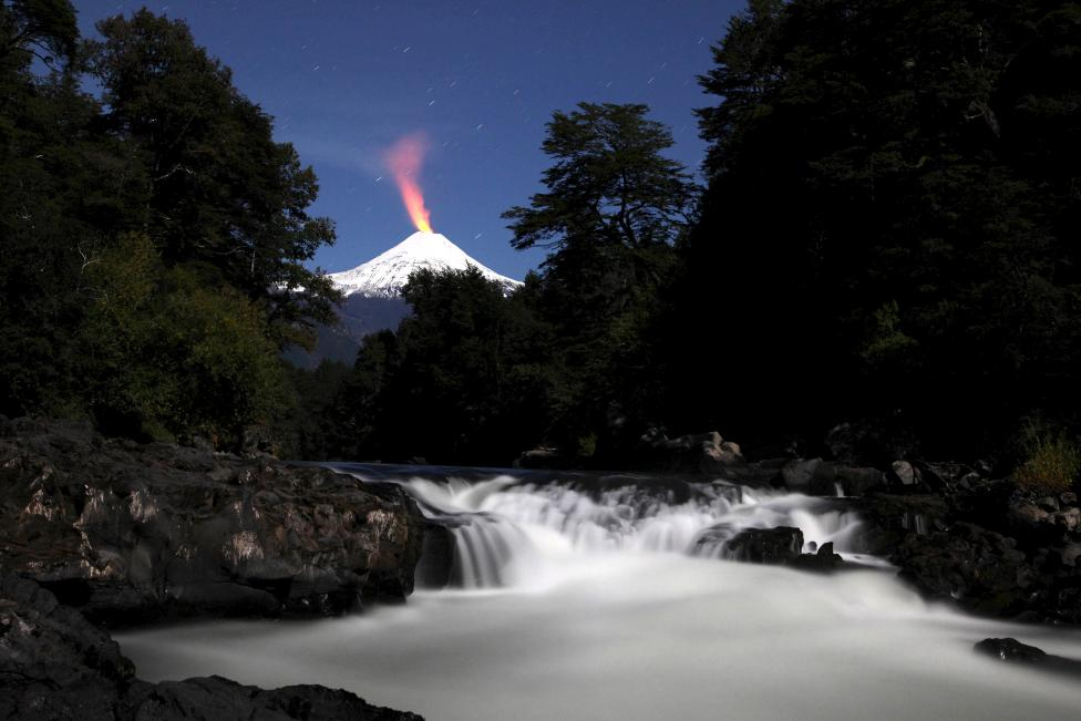 Villarrica Volcano and Trancura river are seen at night in Chile