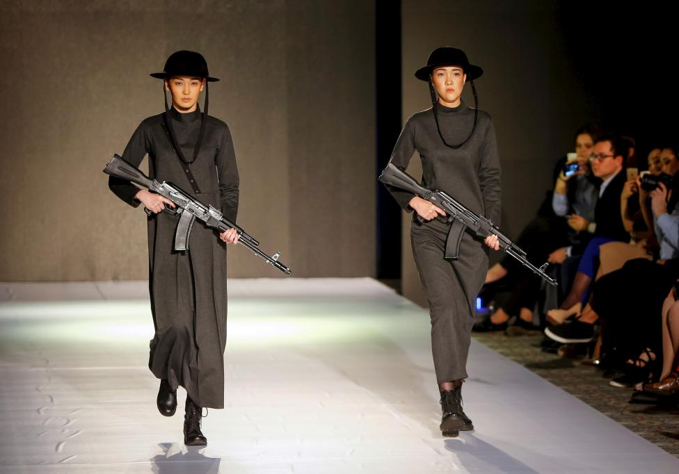 Models present creations by Kazakhstan's design house ABZAL during Kazakhstan Fashion Week in Almaty