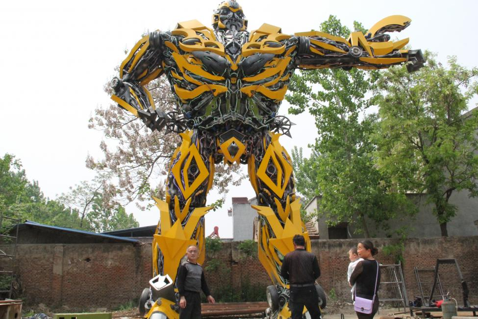 """People look at a replica of a """"Transformer"""", made by a fan, in Shangqiu"""