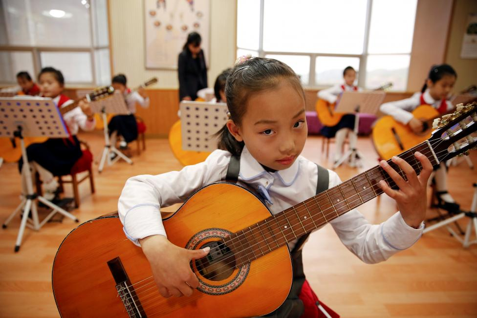 Girls play guitars at the Mangyongdae Children's Palace in central Pyongyang