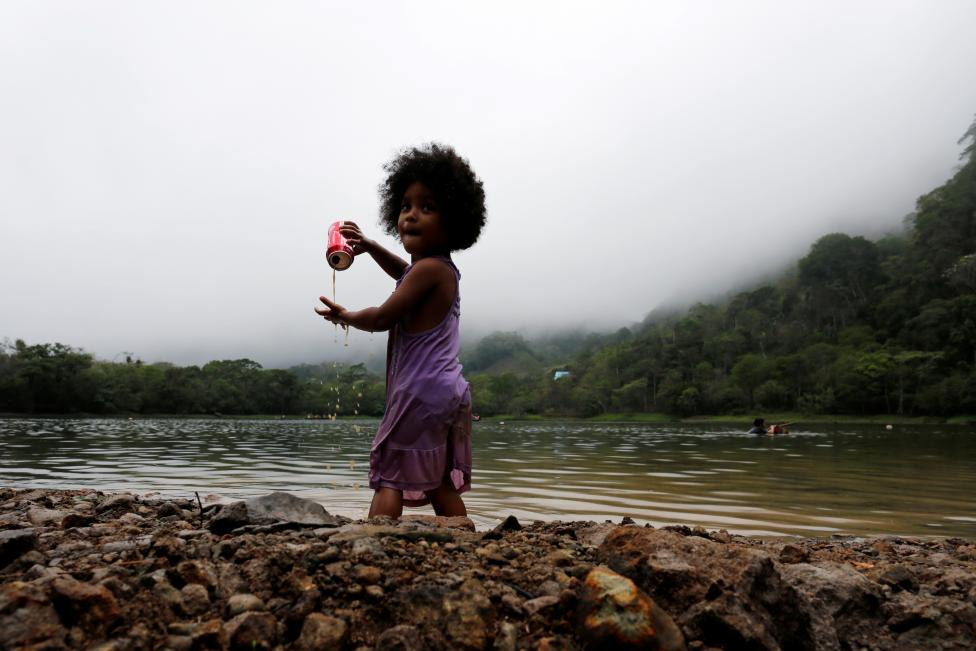 A child plays as she enjoys a day out in Laguna de San Carlos, Panama