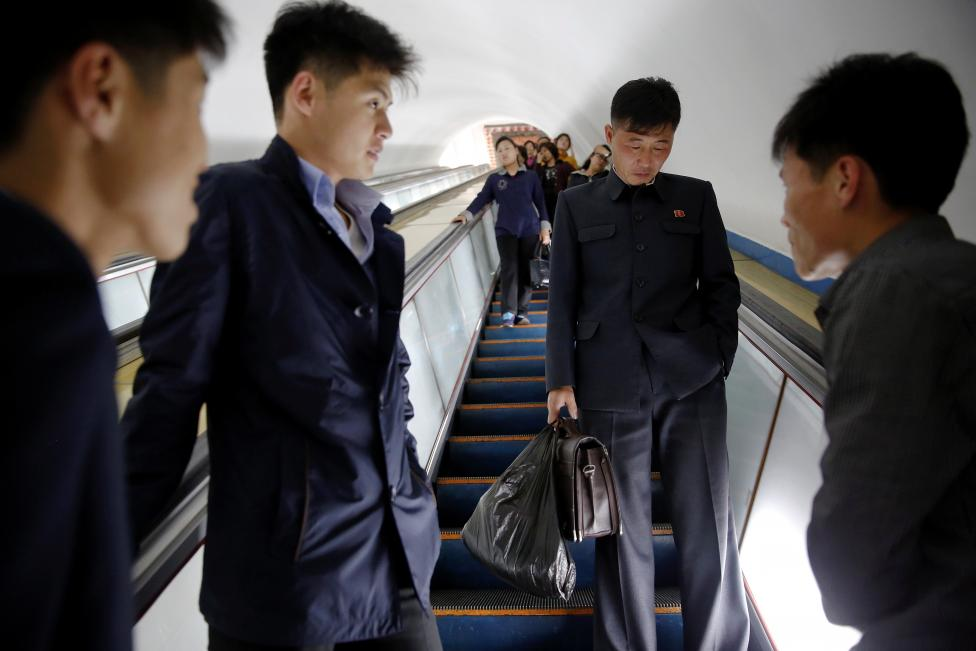 Passengers travel on escalators at a subway in central Pyongyang