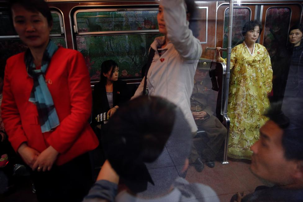 Passengers travel on a train departing the station visited by foreign reporters on a government organised tour in central Pyongyang