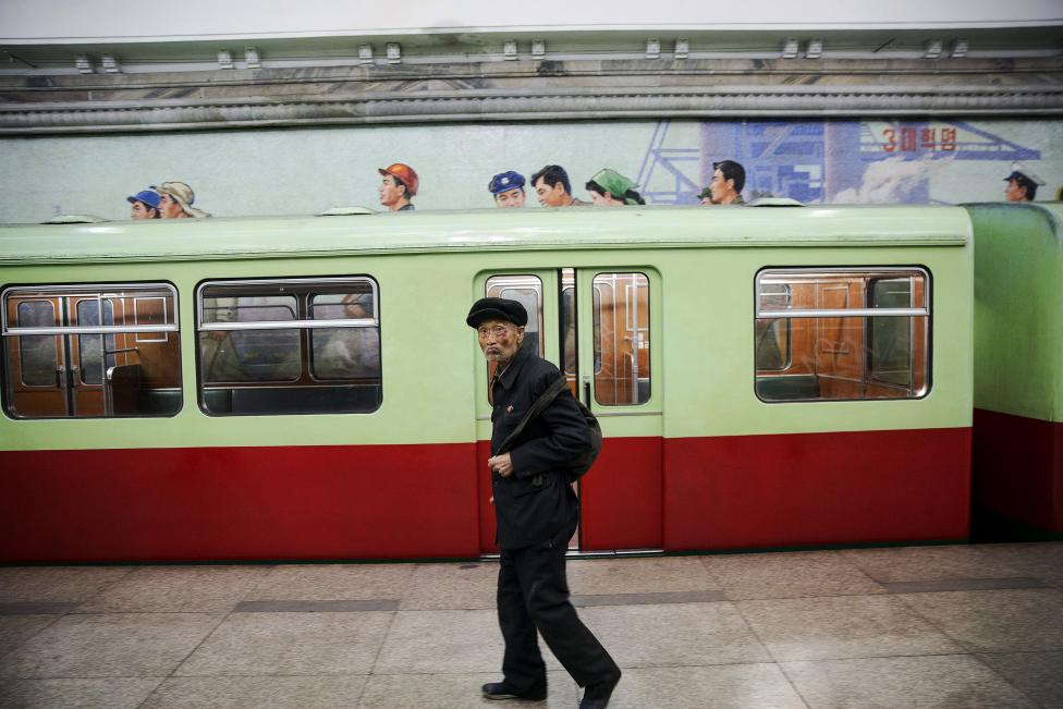 An elderly man arrives at a subway station visited by foreign reporters during a government organised tour in Pyongyang