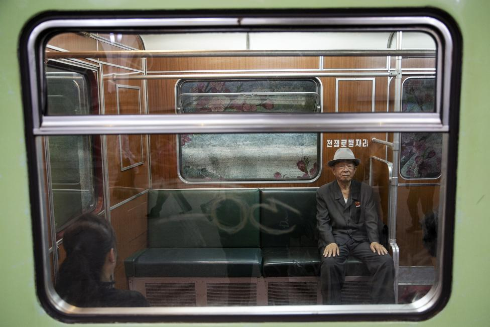 A man looks from inside a train that stopped at a subway station visited by foreign reporters during a government organised tour in Pyongyang