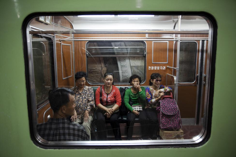 Passengers react inside a train that stopped at a subway station visited by foreign reporters during a government organised tour in Pyongyang