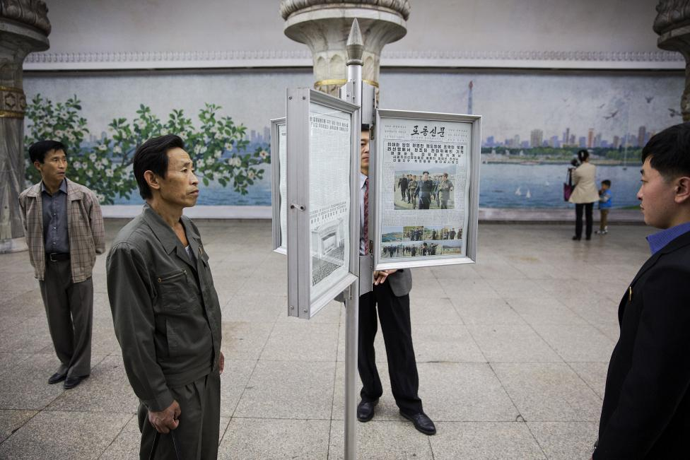 People read newspapers displayed inside a subway station visited by foreign reporters during a government organised tour in Pyongyang. REUTERS/Damir Sagolj
