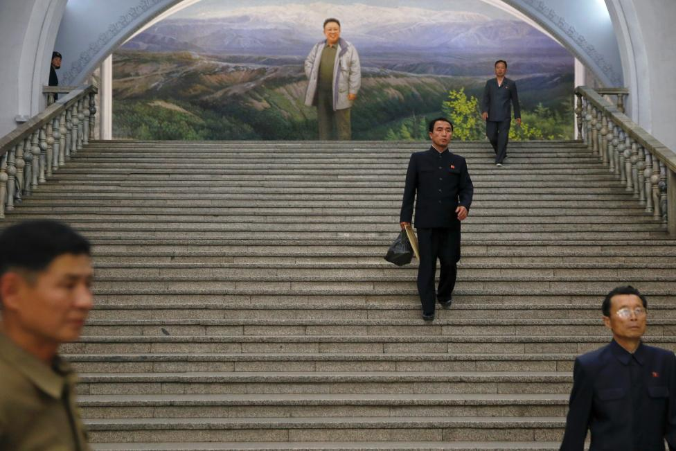 People enter the subway station visited by foreign reporters on a government organised tour in central Pyongyang