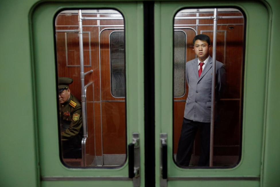 Passengers travel on a subway in central Pyongyang