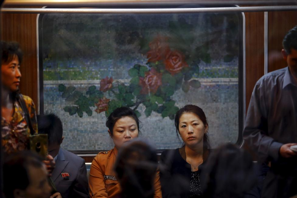 Passengers travel on a train that stopped at a subway station visited by foreign reporters during a government organised tour in Pyongyang
