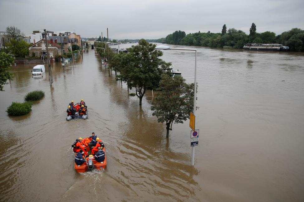 "Rescue workers from the French ""Securite Civile"" on small boats attend an evacuation operation for residents of the edge of the Seine river in Juvisy-sur-Orge"