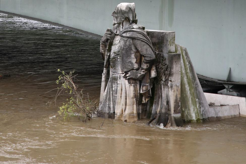 The feet of the Zouave statue on the Pont de l'Alma are covered by the rising waters from the Seine River after days of rainy weather in Paris