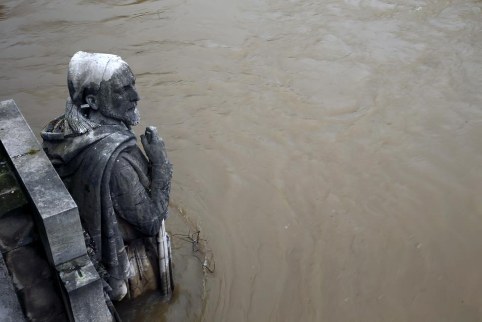 The Zouave statue covered by the rising waters from the Seine River is seen at the Pont de l'Alma after days of rainy weather in Paris