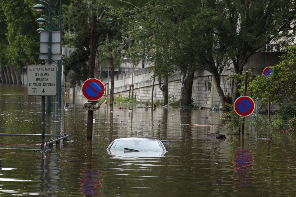 An abandoned car is submerged in deep water on the flooded river-side of the River Seine in Paris