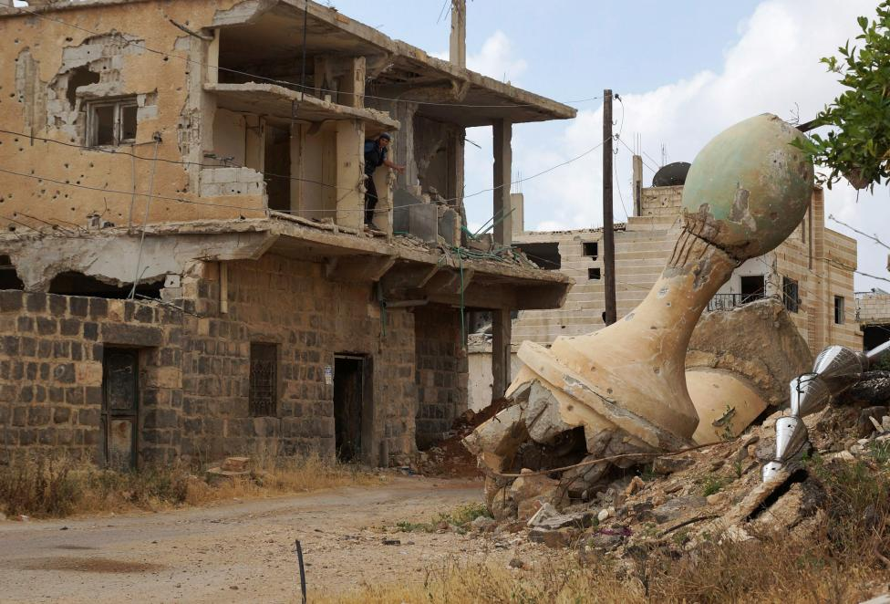 A damaged minaret of a mosque is pictured in the rebel-held area of Deraa