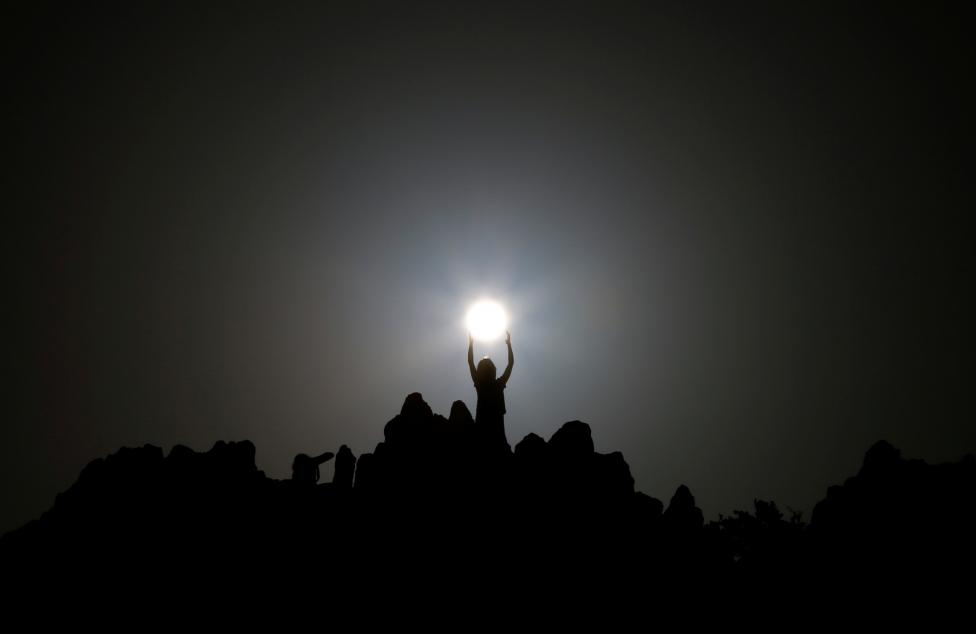 People celebrate the summer solstice at the Kokino megalithic observatory near the city of Kumanovo