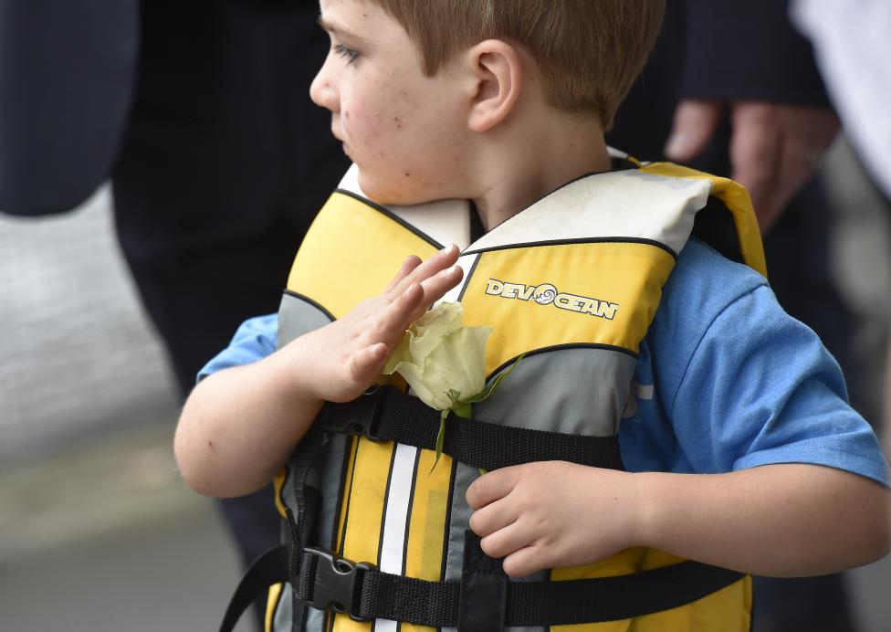 Cuillin Cox, the son of murdered Labour Party MP Jo Cox, arrives by boat to attend a special service at Trafalgar Square in London