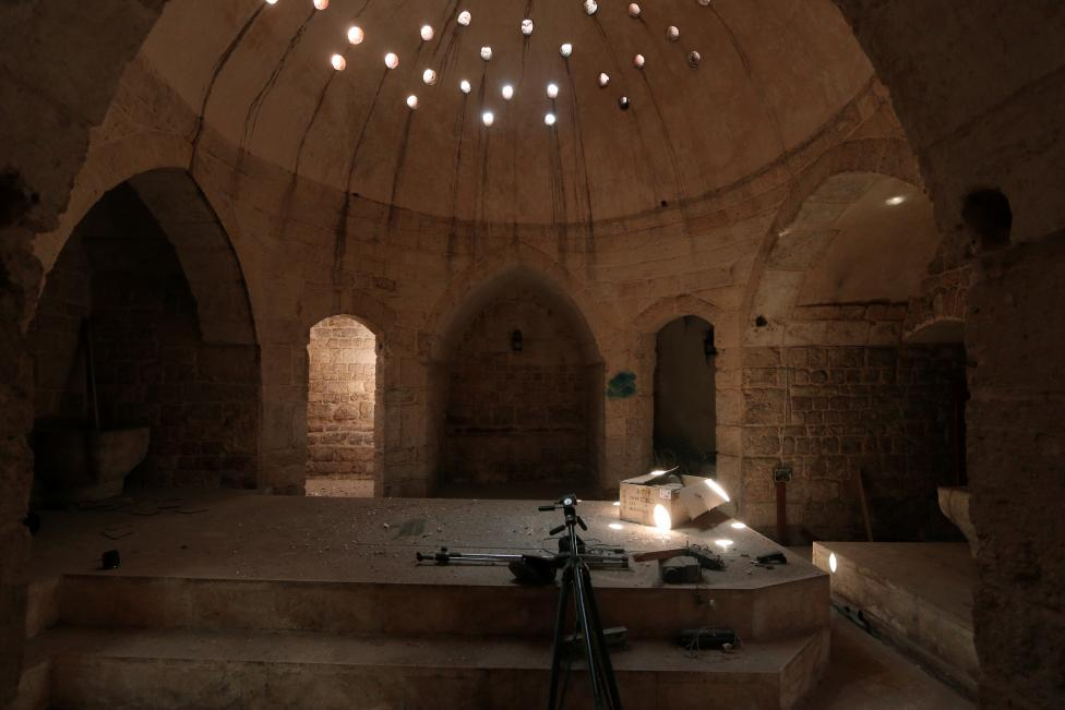 Tripods and a projector are pictured inside an ancient Hammam that was used by Islamic State militants as a media centre in Manbij, in Aleppo Governorate