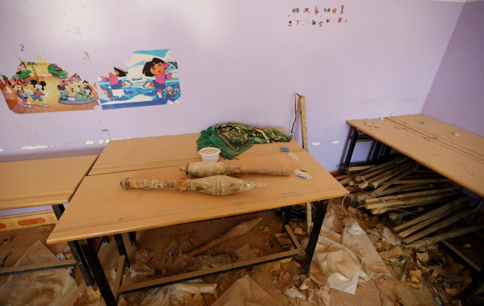 Rocket-propelled grenades left behind by Islamic State militants are seen at a school, following clashes in Falluja, Iraq