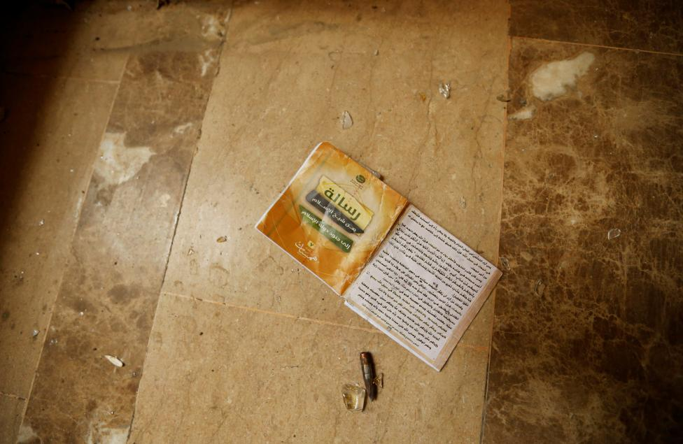 A book belonging to Islamic State militants is seen in Falluja after government forces recaptured the city from Islamic State militants, Iraq