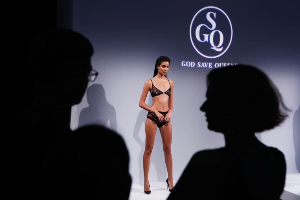 Attendees watch as a model presents creations from God Save Queens Spring/Summer 2017 collection during New York Fashion Week in the Manhattan borough of New York