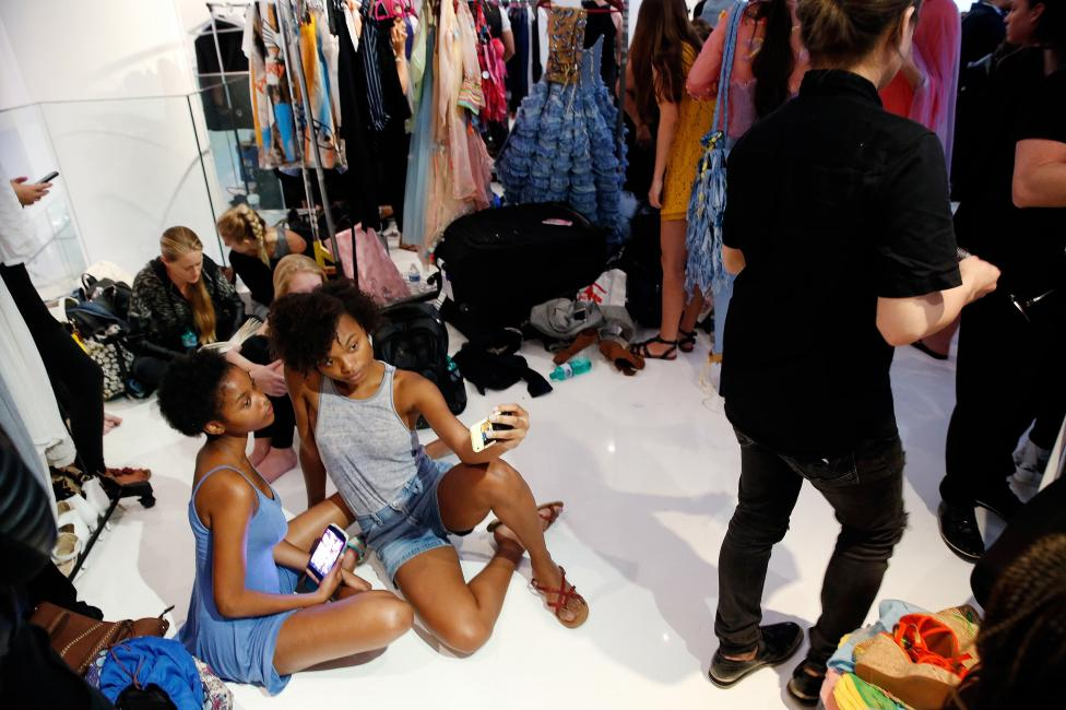 Models prepare backstage before a presentation of the Marlene Spring/Summer 2017 collection during New York Fashion Week in the Manhattan borough of New York