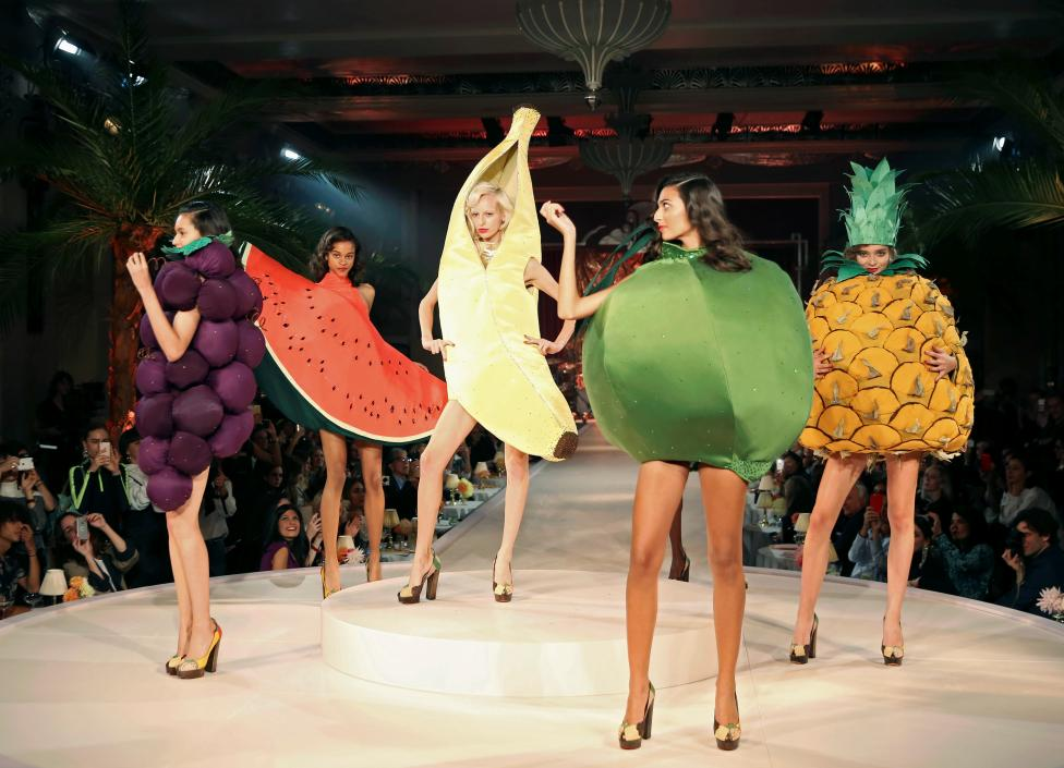 Models present creations at the Charlotte Olympia catwalk show during London Fashion Week Spring/Summer 2017 in London