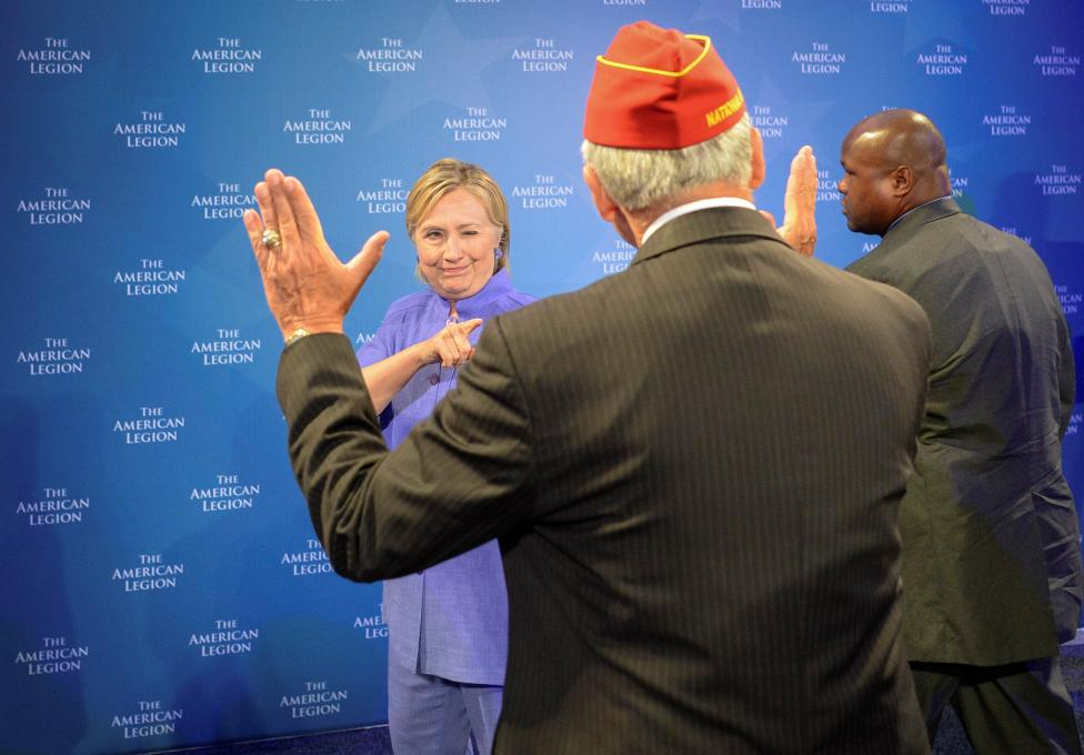 Democratic presidential nominee Hillary Clinton winks at the National Commander of the American Legion Dale Barnett after she addressed the National Convention in Cincinnati