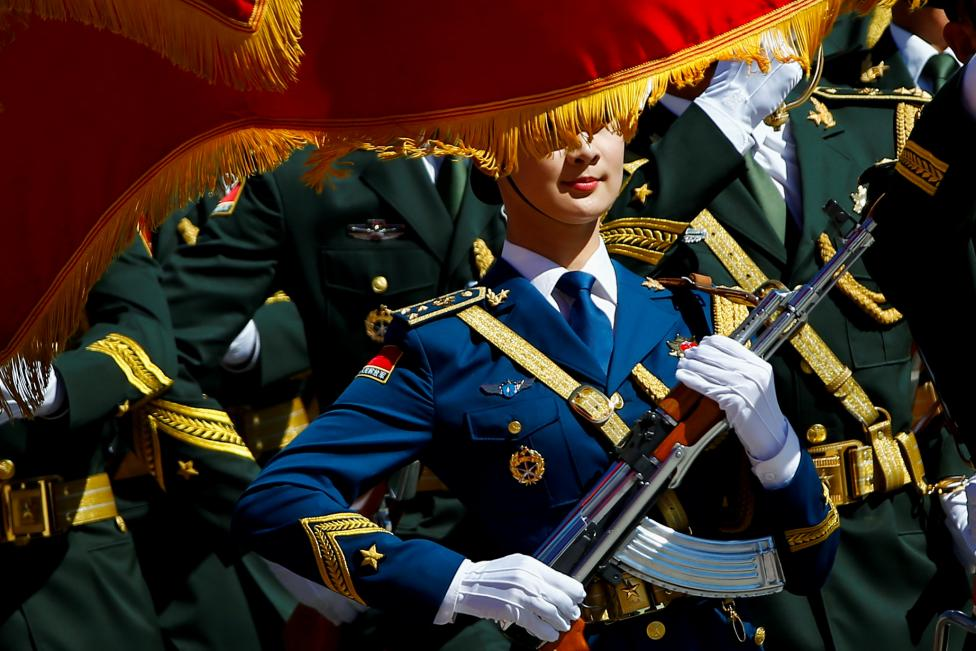 Honour guards march during a welcoming ceremony attended by Chinese Premier Li Keqiang and Canadian Prime Minister Justin Trudeau (not pictured) at the Great Hall of the People in Beijing