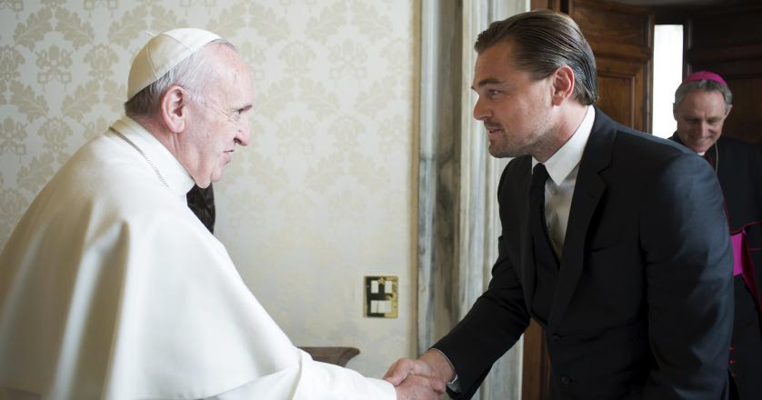 Pope Francis shakes hands with actor Leonardo DiCaprio at the Vatican
