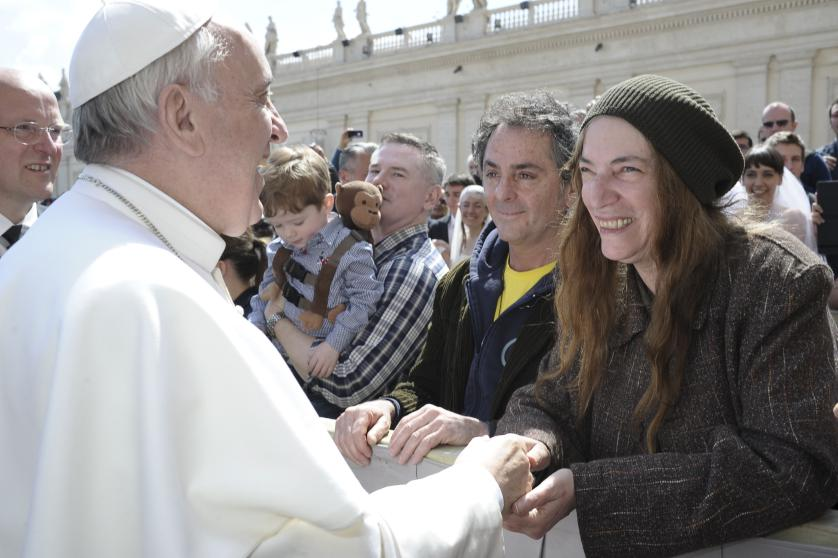 Pope Francis greets U.S. singer Smith during the weekly audience in Saint Peter's Square at the Vatican
