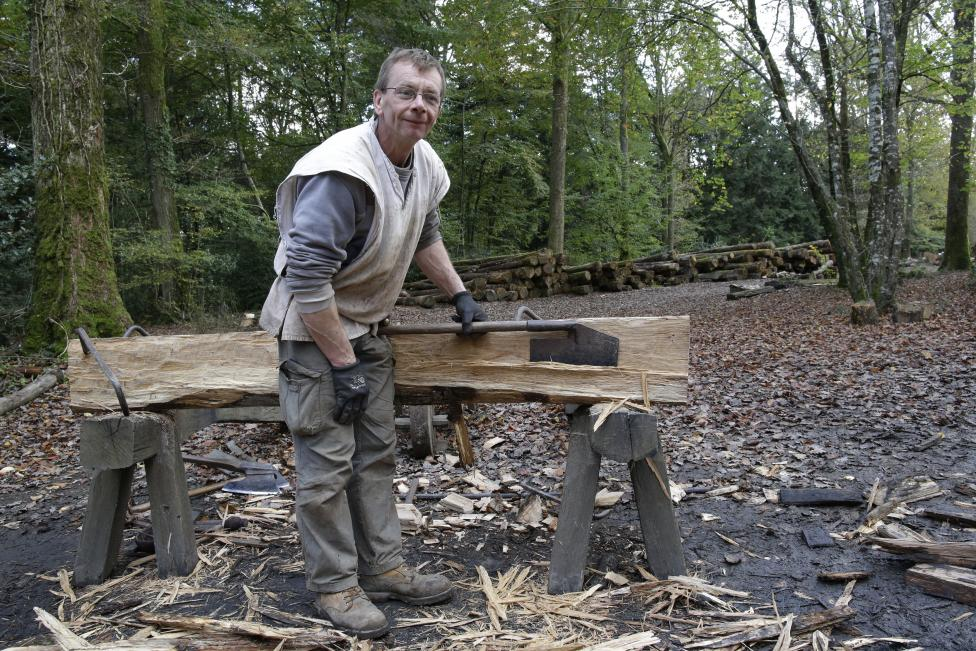 Thierry Baupain, woodcutter at the site since 1999, poses in his workshop at the construction site of the Chateau de Guedelon near Treigny