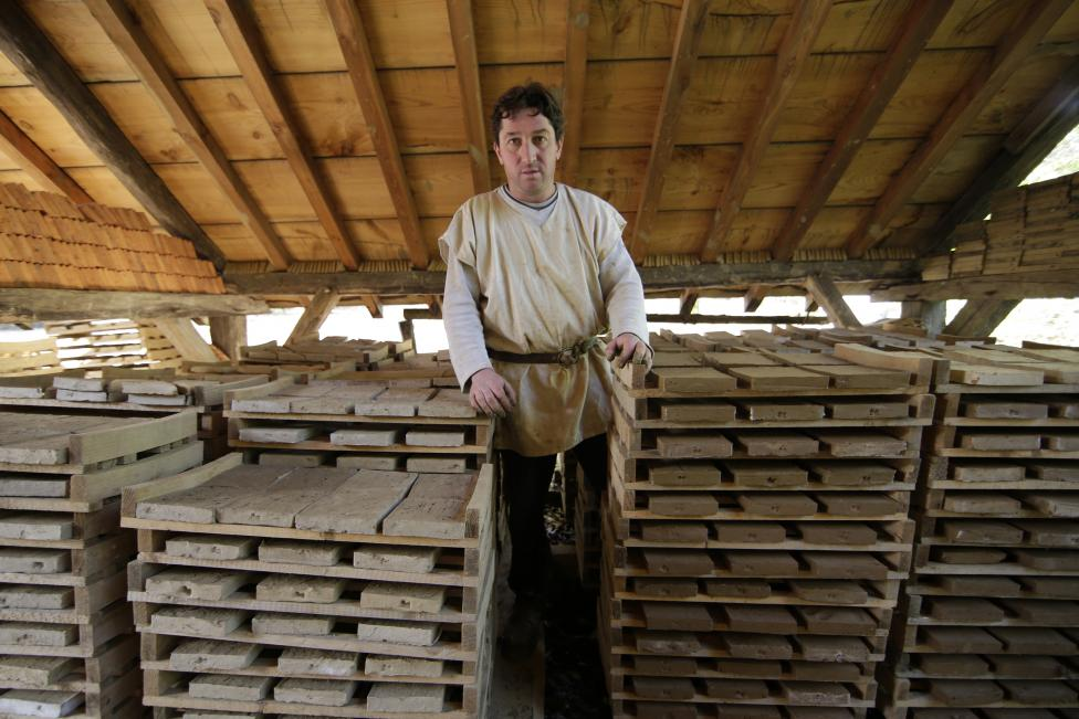 Bruno Feval, tiler at the site since 2004, poses in his workshop at the construction site of the Chateau de Guedelon near Treigny
