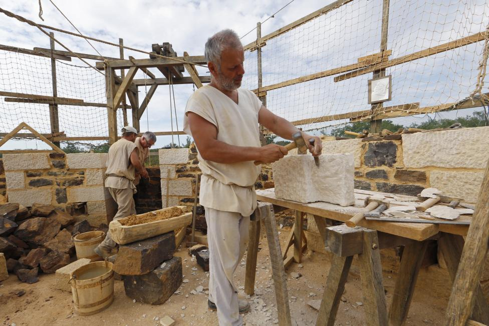A man works at the construction site of the Chateau de Guedelon near Treigny