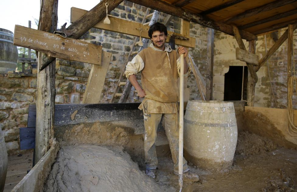 Guillaume Glotin, mason at the site since 2006, poses in his workshop at the construction site of the Chateau de Guedelon near Treigny