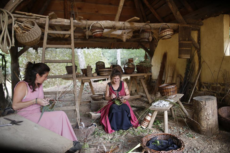 Women work at the construction site of the Chateau de Guedelon near Treigny
