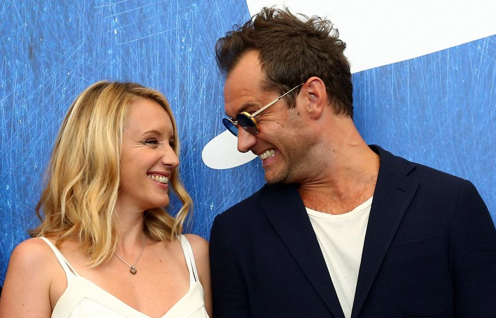 """Actor Jude Law chats with actress Ludivine Sagnier as they attend the photocall for the movie """"The Young Pope"""" at the 73rd Venice Film Festival in Venice"""
